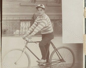 Cute boy on great bicycle antique cabinet photo