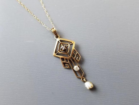 Antique early Art Deco 10K gold Greek Key design diamond and seed pearl long drop lavalier pendant necklace