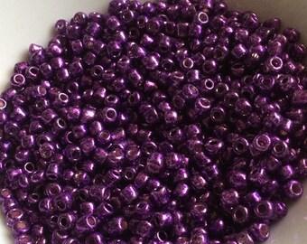 Glass 4mm purple seed beads.