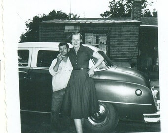 1950s Tall Wife Husband Having Fun by Car Town House 50s Vintage Photograph Black White Photo
