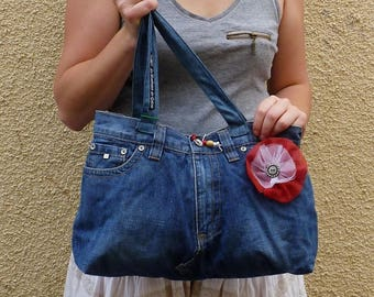 Bag recycled dark blue denim and red and white flower.