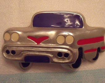 Fun fifties style car brooch in silver tones heavy plastic