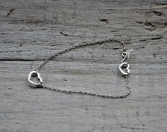 Hearts Bracelet, Sterling Silver with heart charm and handmade heart shaped clasp closure