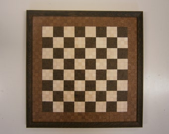 Chessboard in wooden mosaic with draughtsmen and pawns