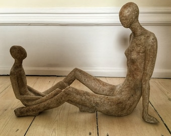 A mother and child sculpture in fibre glass and resin by British artist Joy Stewart