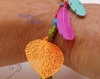 Textile bracelet in thread of multicolored cotton and fine sheets(leaves) everything in lightness(thoughtlessness)