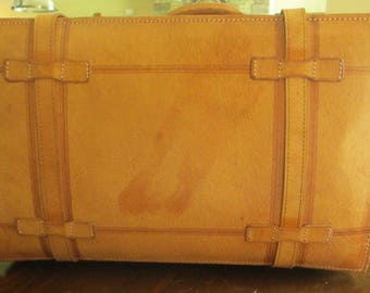 Leather suitcase, straps and buckles, handle
