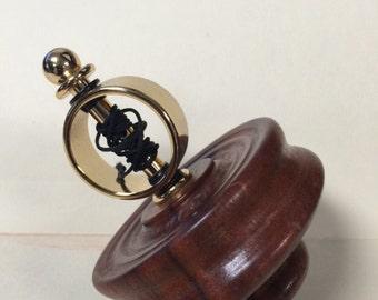Beautiful Linden gyroscopic top.