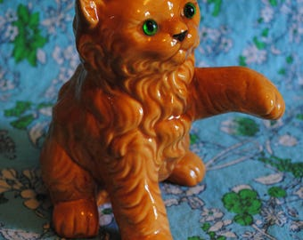 Orange Ceramic cat with green eyes