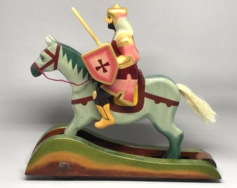 Toy knight with sword riding on horse wood colored