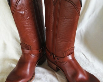 Cinnamin brown leatherlike Western boot. Ankle buckle around boot; stitching on sides, stacked heel,smooth sole.Sz 6 boys; sz 8. women