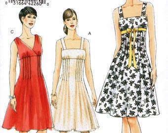 VOGUE 8488 sewing pattern. Dress pattern. Size 14-16-18-20  New.  Uncut.  Factory folded.
