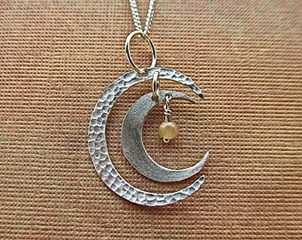 Sterling silver double crescent moon with orange adventurine