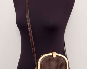 Beautiful reptile leather clutch with gold hardware