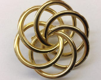 Gold Toned Swirl Pin or Brooch circular Round