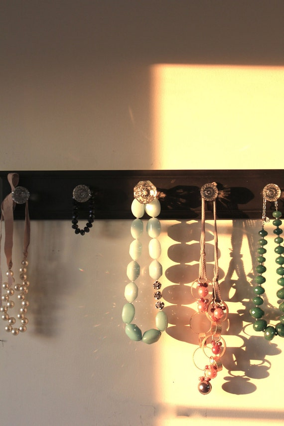 Black distressed glass knob rack