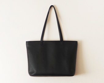 Black leather tote bag with zipper