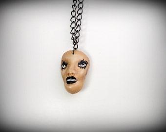 dark lips doll face pendant