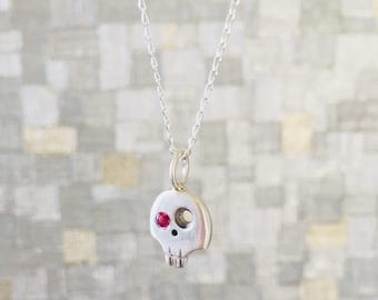 Sterling Silver Skull Necklace with Pink Sapphire