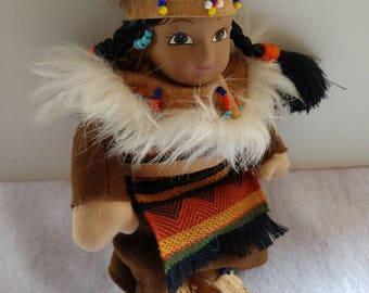Vintage native American porcelain doll.