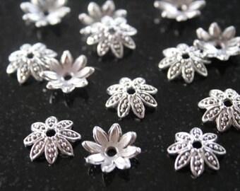 20 bead caps in antique silver. (ref:0051).