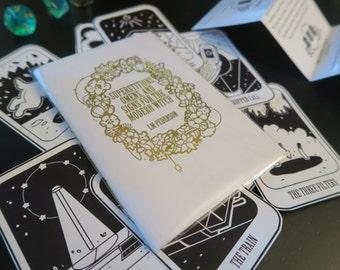 modern witch's superstition book and urban divine deck