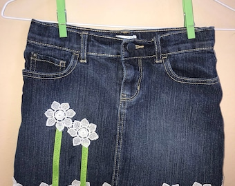 Girls size 8 denim skirt with Spring flowers.