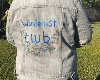 "One Of A kind Hand Painted Denim Jacket With The Saying ""Wonderlust Club"" SIZE XL"