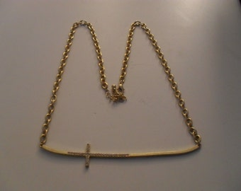 Long gold tone with crystals sideways cross necklace on gold tone chain