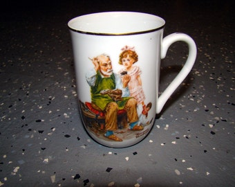 Norman Rockwell (The Cobbler) Coffee Cup - 1982 Collectible
