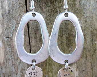 Ring and silver sequin earrings