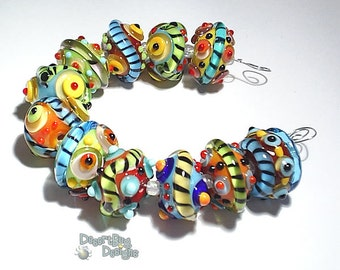 SPICE of LIFE Handmade Lampwork Beads - Turquoise Blue Red Yellow Green - Bold and Wild -  11 Beads