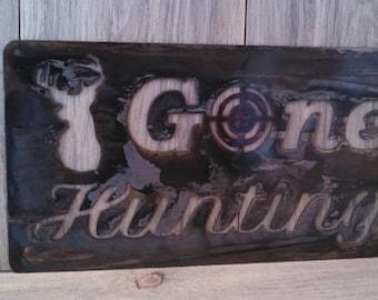 Gone Hunting metal sign