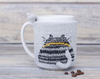 Knitted coffee mug cozy, Party favor, Cat lover gift, Mug sweater, Black white kitten, Tea sleeve,  Cup warmer, Coffee cosy, Hot drink cozy