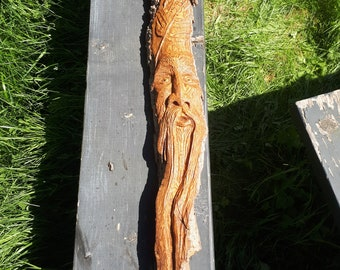 wood spirit with maple leafs