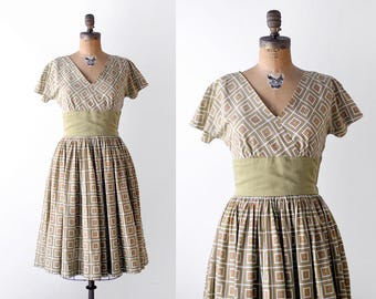 1950's olive green dress. cotton. 50 small pleated dress. full skirt. patterned print.