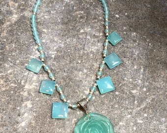 Chalcedony Quartz and Sterling Silver necklace with a flower pendant.