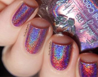 "Nail polish - ""Fix Up, Look Sharp""  A purple strong holo"