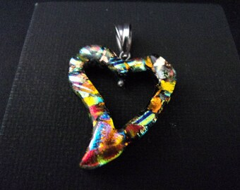 Handmade Dichroic glass free form heart with sterling silver bail.