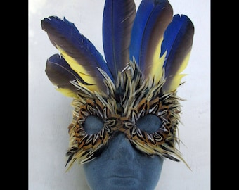 Tiger Mardis Gras Feather Mask Accented by a Crown of Macaw Wings and a hint of Gold
