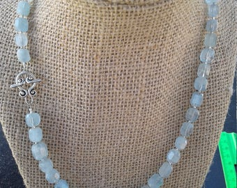 Aquamarine faceted  beaded necklace with sterling silver spacers and clasp