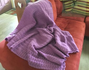 Crocheted orchid afghan done in shell pattern. This afghan is 42x54 inches.