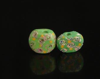 V 058-  Two nice green tabular fancy beads