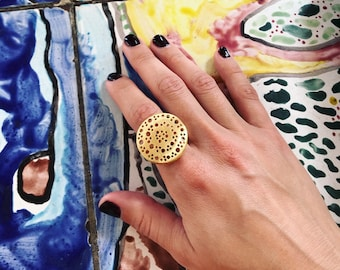 Textured Golden Saucer Ring   Luscious texture and circle motif make this ring truly unique.
