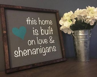This house is built online and shenanigans painted solid wood sign