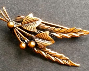 Copper finished brooch
