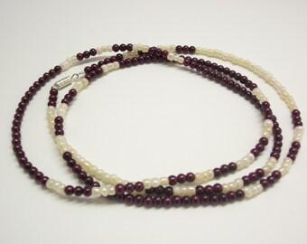 Grape and cream pearl necklace.