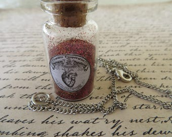 Apothecary Jar Of Ground Heart Dust With Heart Charm Necklace