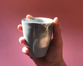 Unique handcrafted porcelain cup