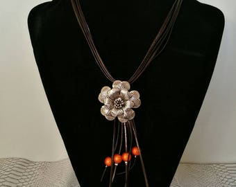 Brown leather, flower pendant necklace and orange beads